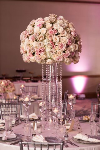 wedding reception tall centerpiece pink ivory roses crystals floating candles silver chairs