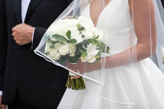 bride walking down aisle with father of bride veil over white bouquet hydrangea rose greenery gardenia