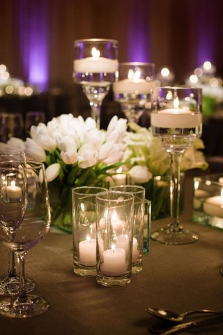 wedding-reception-purple-lighting-floating-candles-candle-votives-white-tulips-in-clear-glass-vase