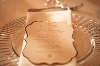 wedding-reception-clear-glass-charger-plate-white-napkin-white-gold-menu-card-die-cut-gold-border