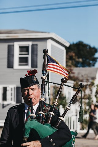 bagpiper-with-american-flag-performing-outside-of-church-ceremony
