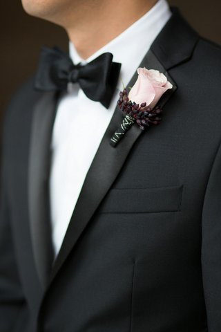 groom-in-tuxedo-with-pink-rose-boutonniere-and-black-silver-ribbon