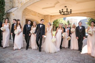bridesmaids-and-groomsmen-walk-with-couple-at-dallas-country-club-venue
