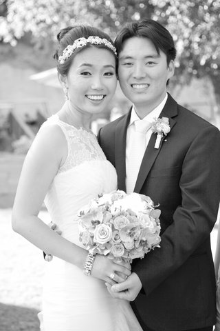 black-and-white-photo-of-bride-in-a-vera-wang-dress-with-lace-neckline-groom-in-vera-wang-in-black