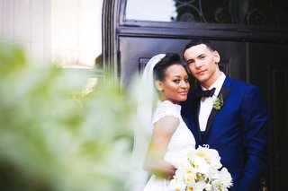 african-american-couple-wedding-at-vibiana-blue-tuxedo-black-lapel-high-neck-lace-bridal-gown