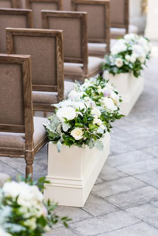 wedding-ceremony-wood-chairs-white-flower-box-with-greenery-rose-peony-flowers-stone-pathway