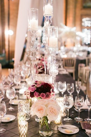rectangle-reception-table-with-low-rose-and-purple-centerpieces-tall-clear-candleholders-acrylic