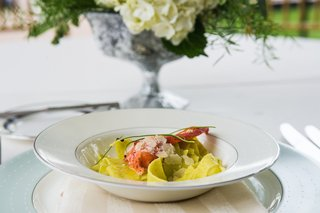 wedding-reception-dinner-dish-of-pappardelle-pasta-and-lobster-claw-on-monique-lhuillier-china