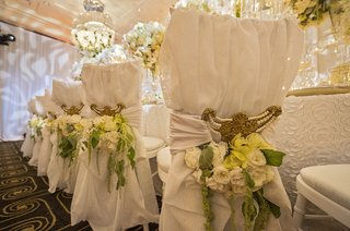 gold-chair-interlaces-with-yellow-orchids-white-roses-and-green-amaranths