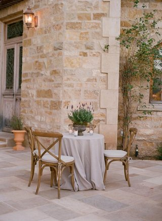 linen-tablecloth-surrounded-by-wood-chairs