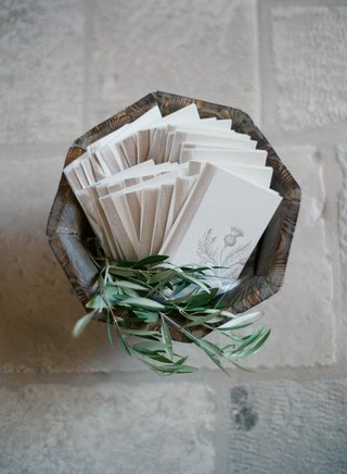 wood-basket-filled-with-herbs-and-ceremony-booklets