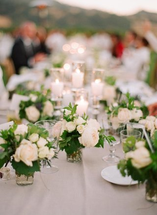 pillar-candles-and-small-floral-arrangements