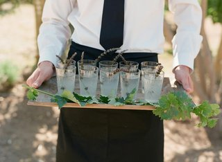 drinks-garnished-with-lavender-sprigs-on-wood-tray