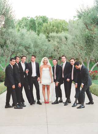 simone-harouche-designer-in-a-carolina-herrera-gown-with-groomsmen-in-black-tom-ford-suits