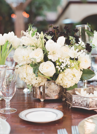 wedding-reception-table-with-white-flowers-in-low-sterling-vases