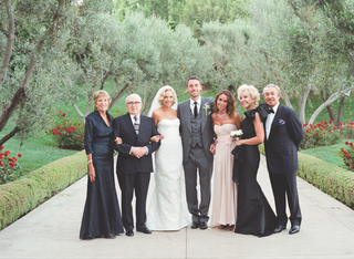 simone-harouche-in-a-strapless-carolina-herrera-gown-groom-in-a-grey-tom-ford-suit-with-family