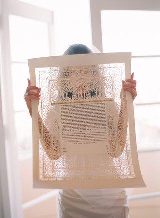 bride-examines-her-ketubah