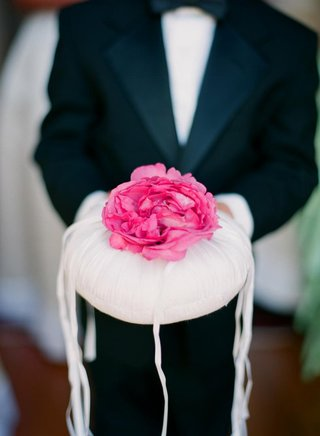 ring-bearer-holding-circular-pillow-with-flower