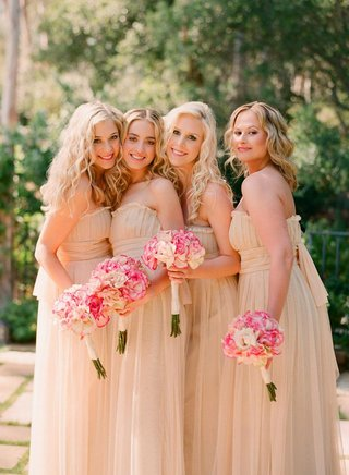 bridesmaids-in-strapless-gowns-and-curled-hair