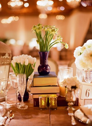 small-floral-arrangements-atop-stack-of-books