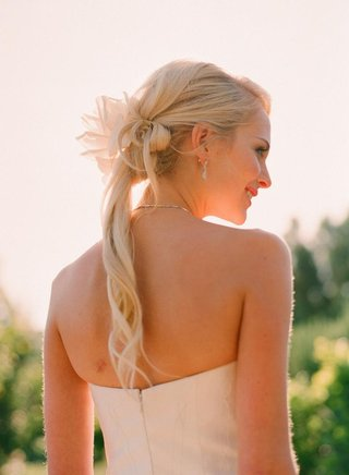 bride-with-flower-in-hair-and-thin-curls