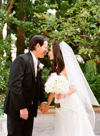 bride-and-groom-at-the-wetherly-garden-of-the-four-seasons-los-angeles-at-beverly-hills