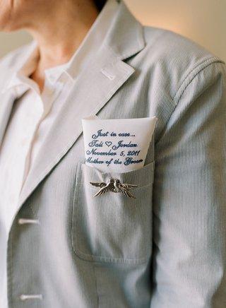 dove-pin-and-hanky-tucked-into-jacket-pocket