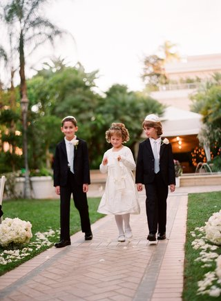flower-girl-in-a-long-sleeve-dress-with-bridal-party-boy-attendants-in-black-tuxedos-and-grey-ties