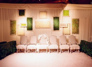 the-veiling-ceremony-chairs-and-framed-greenery
