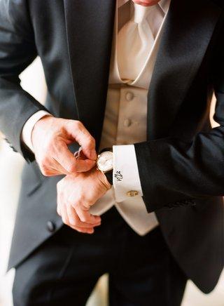 groom-in-a-black-tuxedo-white-satin-vest-and-tie