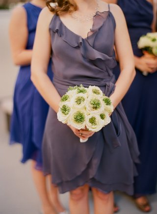 bridesmaids-in-different-dresses-holding-flowers