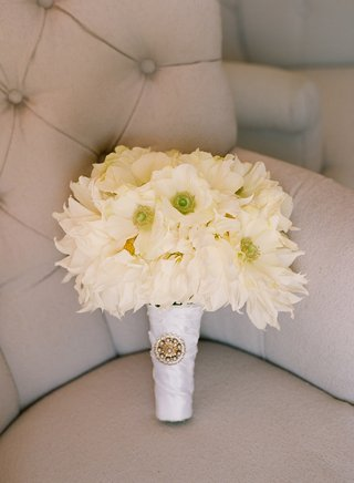 white-flowers-wrapped-in-ribbon-with-brooch