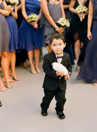 little-boy-in-dark-suit-with-bow-tie-and-ring-pillow