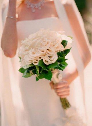 bride-holding-monochromatic-flowers