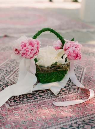 grass-basket-with-petals-on-persian-rug
