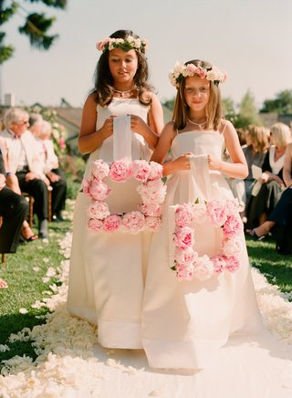 flower-girls-holding-pink-rose-frame-down-aisle