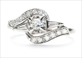 mid-century-kingston-ring-in-14k-white-gold-featuring-a-0-13ct-transitional-cut-diamond-with-pave