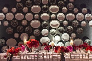 wall-of-serving-plates-with-rectangular-wedding-table