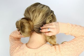 bride-doing-diy-wedding-day-hairstyle-sock-bun