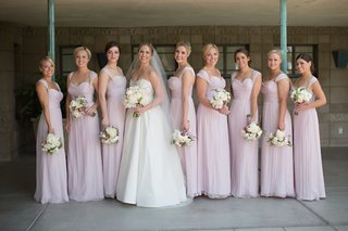 bridesmaids-in-long-light-purple-gowns-with-sweetheart-necklines