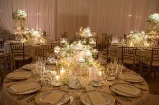 wedding-reception-round-table-low-centerpiece-candles-and-white-flowers