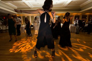 guests-dancing-choreographed-dance-at-wedding-reception