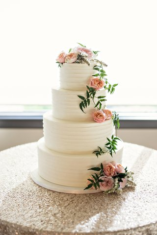 four-tiered-wedding-cake-with-buttercream-frosting-blush-garden-roses-greenery
