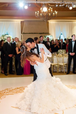 bride-in-sparkling-headband-ines-di-santo-dress-groom-in-white-tux-jacket-kiss-on-dance-floor