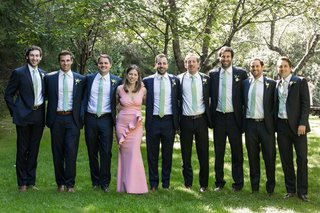 groom-with-groomsmen-in-light-green-ties-groomswoman-best-woman-groom-sister-in-pink-dress