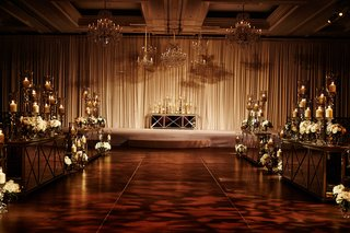 opulent-chicago-wedding-ceremony-decor-with-drapery-chandeliers-white-flowers-mirror-details