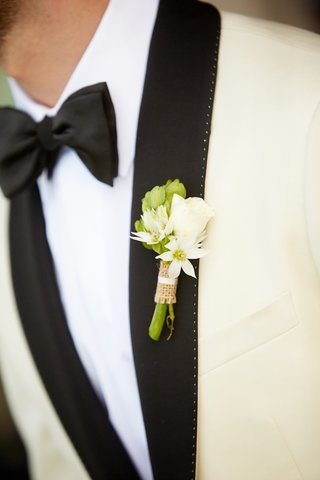 white-rosebud-and-greenery-wrapped-in-burlap