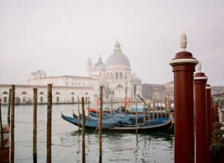 view-of-canal-and-gondola-boats-in-venice-italy-wedding-destination