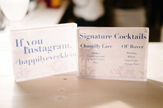 instagram-hashtag-sign-and-signature-cocktail-menu-in-acrylic-rectangle-stands-on-bar
