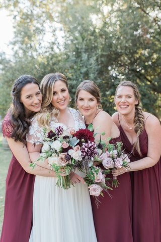 bride-in-jina-couture-bridal-gown-lace-short-sleeves-bridesmaids-in-marsala